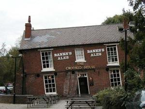 """Crooked house dudley"". Licensed under Public Domain via Wikipedia - http://en.wikipedia.org/wiki/File:Crooked_house_dudley.jpg#/media/File:Crooked_house_dudley.jpg"